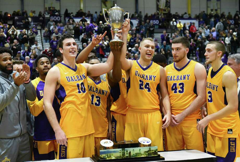 The University at Albany basketball team celebrates after defeating Siena in the Albany Cup basketball game at UAlbany on Sunday, Nov. 27, 2016 in Albany, N.Y. (Lori Van Buren / Times Union) Photo: Lori Van Buren / 20038932A