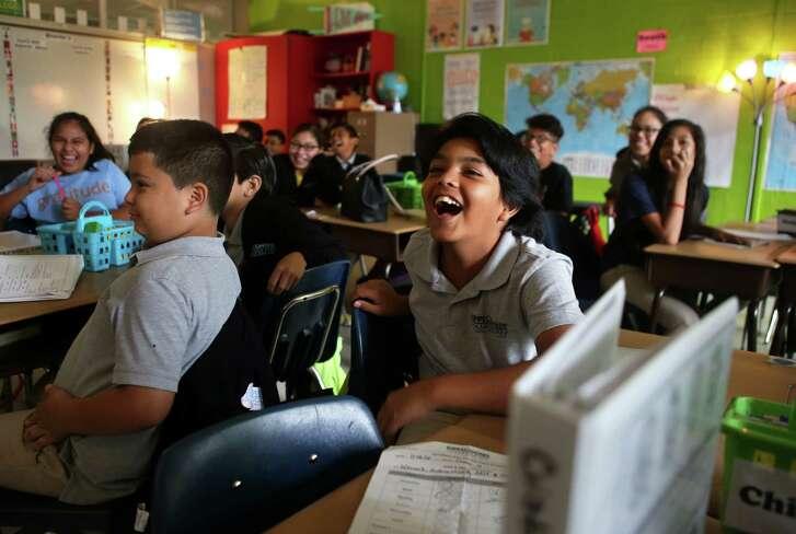 Sixth-grade KIPP student Cesar Hernandez laughs during a class at Landrum Middle School.