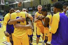 The University at Albany basketball team celebrates after defeating Siena in the Albany Cup basketball game at UAlbany on Sunday, Nov. 27, 2016 in Albany, N.Y. (Lori Van Buren / Times Union)