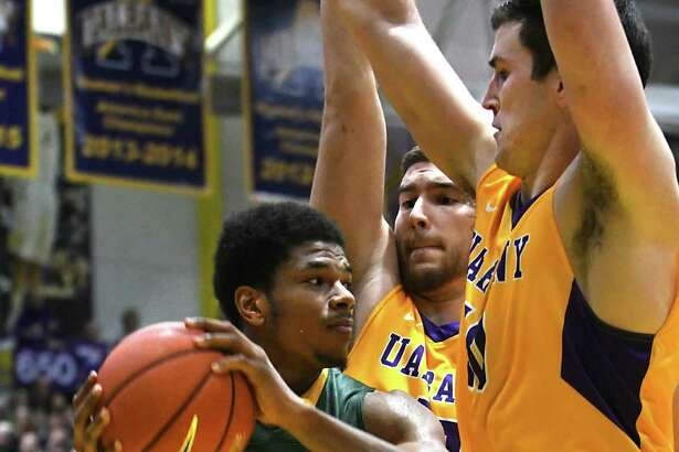 University at Albany's Greig Stire, center, and Mike Rowley defend Siena's Lavon Long, left, during the Albany Cup basketball game at UAlbany on Sunday, Nov. 27, 2016 in Albany, N.Y. (Lori Van Buren / Times Union)