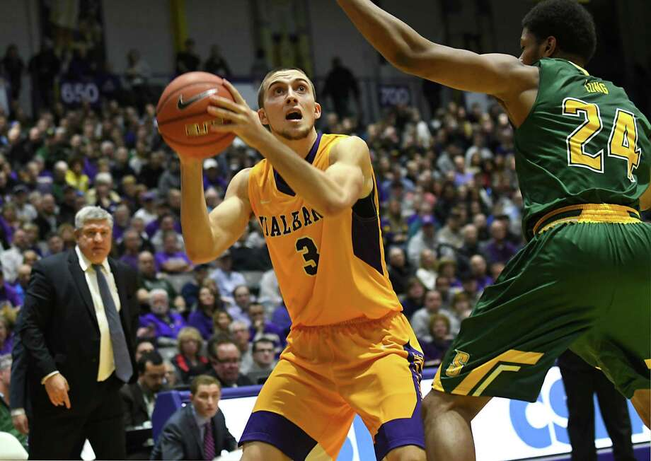 University at Albany's Joe Cremo, left, is defended by Siena's Lavon Long during the Albany Cup basketball game at UAlbany on Sunday, Nov. 27, 2016 in Albany, N.Y. (Lori Van Buren / Times Union) Photo: Lori Van Buren / 20038932A
