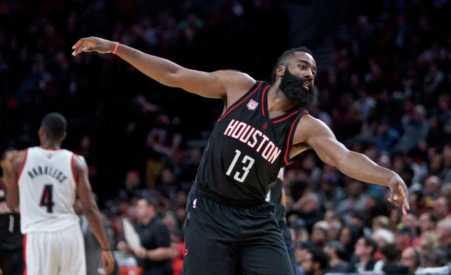 Houston Rockets guard James Harden reacts after making a basket against the Portland Trail Blazers during the second half of an NBA basketball game in Portland, Ore., Sunday, Nov. 27, 2016. The Rockets won 130-114. (AP Photo/Craig Mitchelldyer) Photo: Craig Mitchelldyer, Associated Press / FR170751 AP