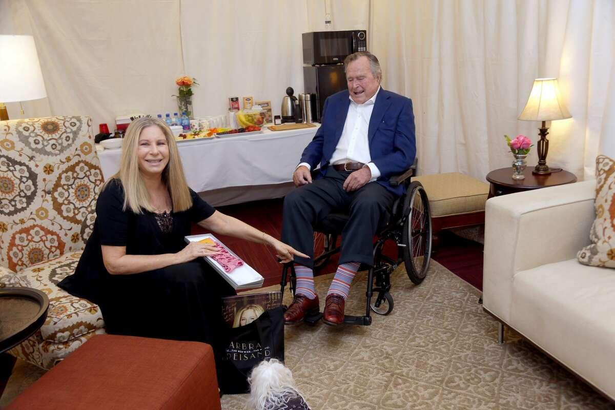 Barbra Streisand and Former President George H.W. Bush speak backstage during the
