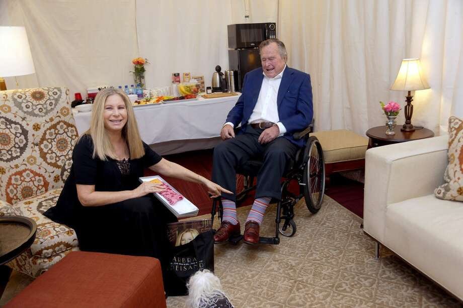 "Barbra Streisand and Former President George H.W. Bush speak backstage during the ""Barbra - The Music... The Mem'ries... The Magic! Tour"" at Toyota Center on November 27, 2016 in Houston, Texas.  Photo: Bob Levey/WireImage"