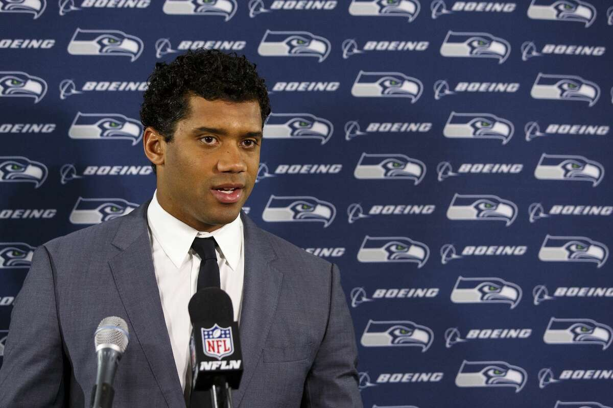 Quarterback Russell Wilson #3 of the Seattle Seahawks answer questions from the media during a press conference after the game against the Tampa Bay Buccaneers at Raymond James Stadium on November 27, 2016 in Tampa, Florida. The Bucs defeated the Seahawks 14 to 5. (Photo by Don Juan Moore/Getty Images)