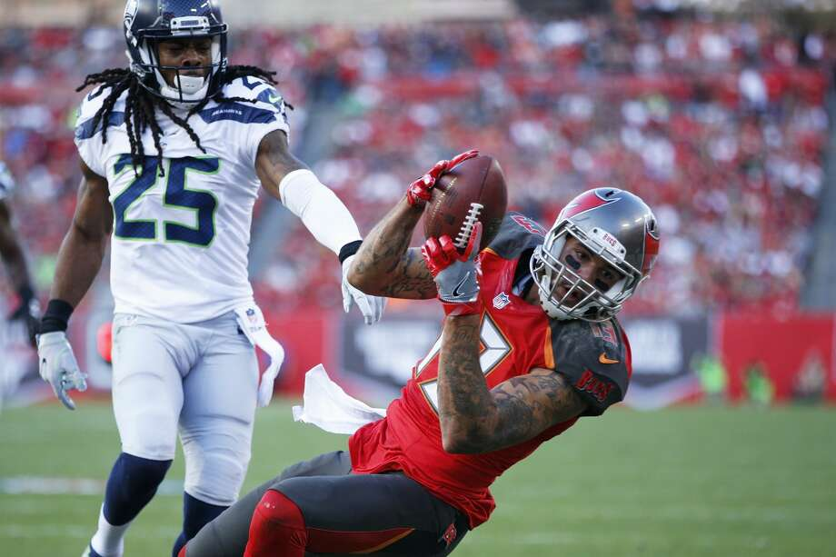 Mike Evans #13 of the Tampa Bay Buccaneers makes a 23-yard touchdown reception behind Richard Sherman #25 of the Seattle Seahawks in the first quarter of the game at Raymond James Stadium on November 27, 2016 in Tampa, Florida. (Photo by Joe Robbins/Getty Images) Photo: Joe Robbins/Getty Images