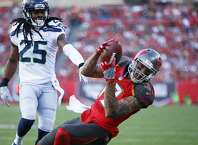 Mike Evans #13 of the Tampa Bay Buccaneers makes a 23-yard touchdown reception behind Richard Sherman #25 of the Seattle Seahawks in the first quarter of the game at Raymond James Stadium on November 27, 2016 in Tampa, Florida. (Photo by Joe Robbins/Getty Images)