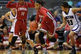 Crosby sophomore guard Paris Netherly leads a fast break against Canyon junior guard Angel Hayden (23) in the fourth quarter of their Class 5A girls basketball state semifinal at the Alamodome in San Antonio on March 3, 2016.