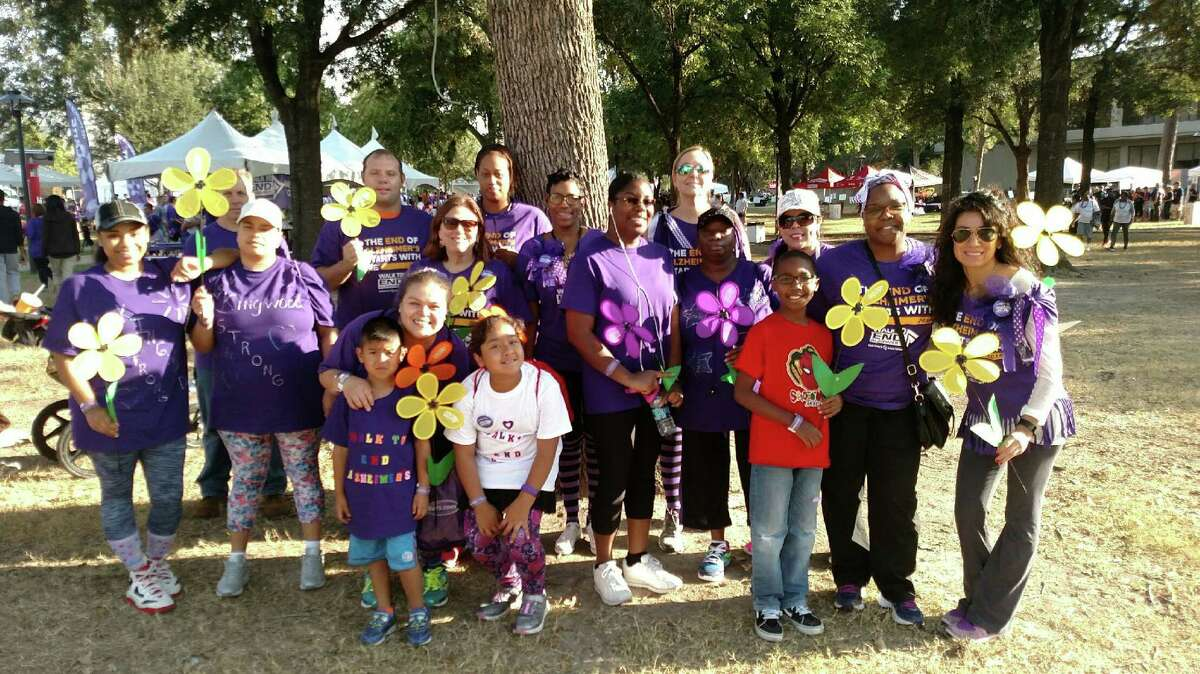 Members and supporters of the Isle at Kingwood's team, Kingwood Strong, pose for a photo at the 2016Houston Walk to End Alzheimer's Nov. 5.