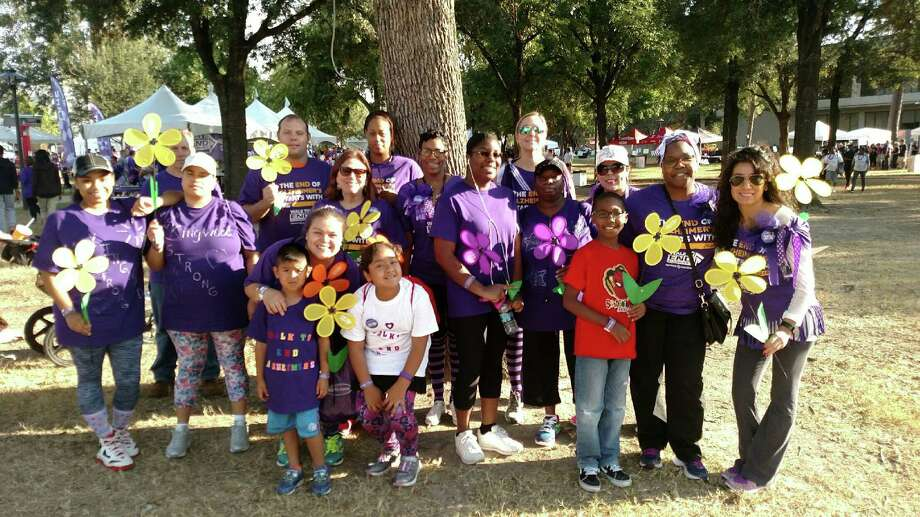 Members and supporters of the Isle at Kingwood's team, Kingwood Strong, pose for a photo at the 2016Houston Walk to End Alzheimer's Nov. 5. Photo: Courtesy OfPolly Moreau