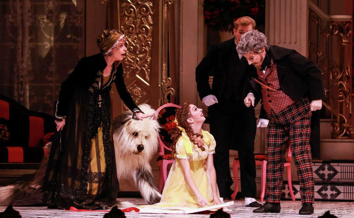 Melody Mennite, center, as Clara, shows her new book to her grandparents as the butler and the family dog look on.