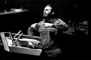 Bearded Cuban Premier Fidel Castro jabs two fingers together as he addressed the United Nations General Assembly in a lengthy speech, September 26, 1960, in New York. (AP Photo)