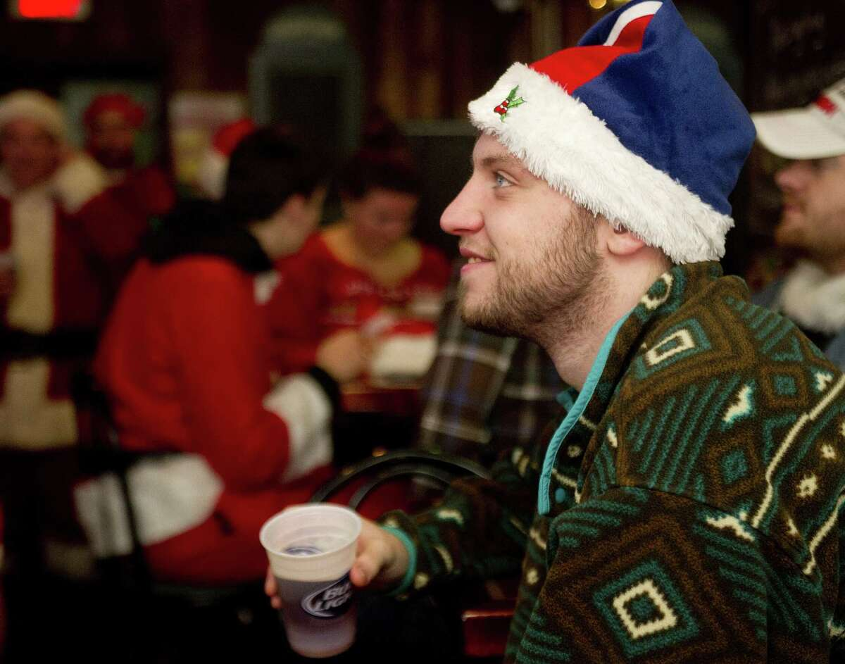 Marcel Riccelli relaxes at Murphy's during Stamford SantaCon on Saturday, December 6, 2014.