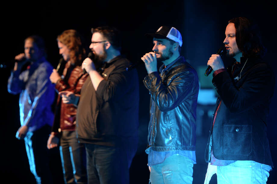 "Home Free, an a cappella group that won season four of ""The Sing-Off,"" performs at the Nederland High School Performing Arts Center on Saturday evening. Tim Foust, right, is a native of Nederland.  Photo taken Saturday 11/26/16 Ryan Pelham/The Enterprise Photo: Ryan Pelham / ©2016 The Beaumont Enterprise/Ryan Pelham"