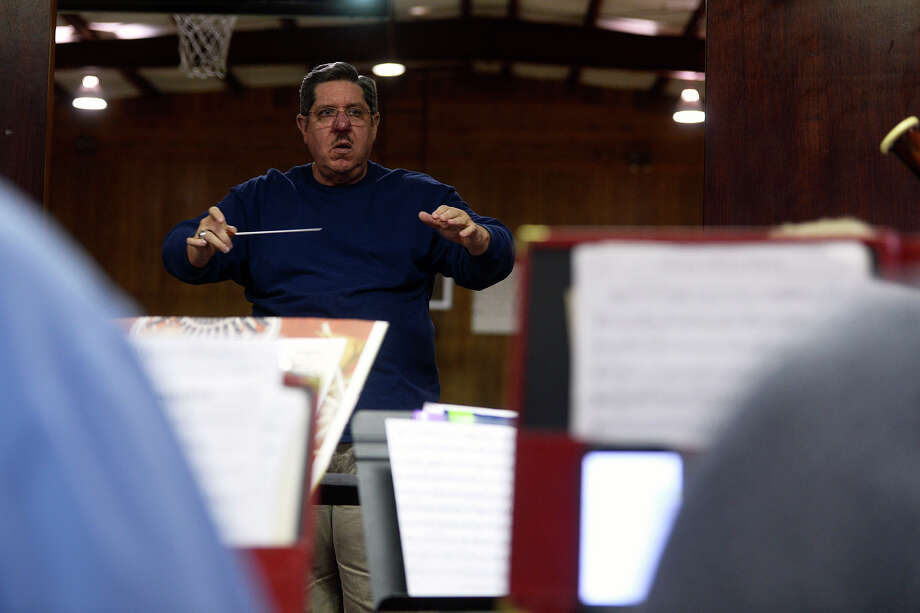 Conductor Art Ferris leads the Community Band of Southeast Texas while they rehearse Christmas music for their upcoming December show.  Photo taken Thursday 11/17/16 Ryan Pelham/The Enterprise Photo: Ryan Pelham / ©2016 The Beaumont Enterprise/Ryan Pelham