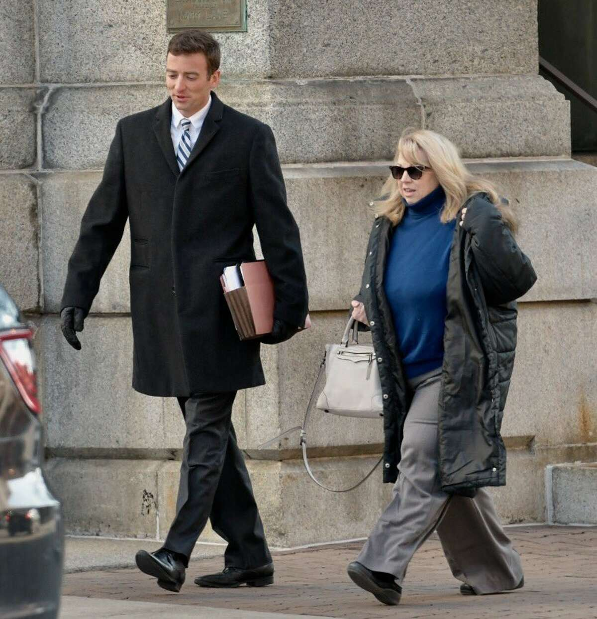 Diane Backis, right, heads to U.S. District Court with her attorney, Steve Eisenman, on Monday morning. Backis, an accounting official with the Cargill company, pleaded guilty to federal charges, admitting she stole $3.1 million from the company. (Skip Dickstein / Times Union)