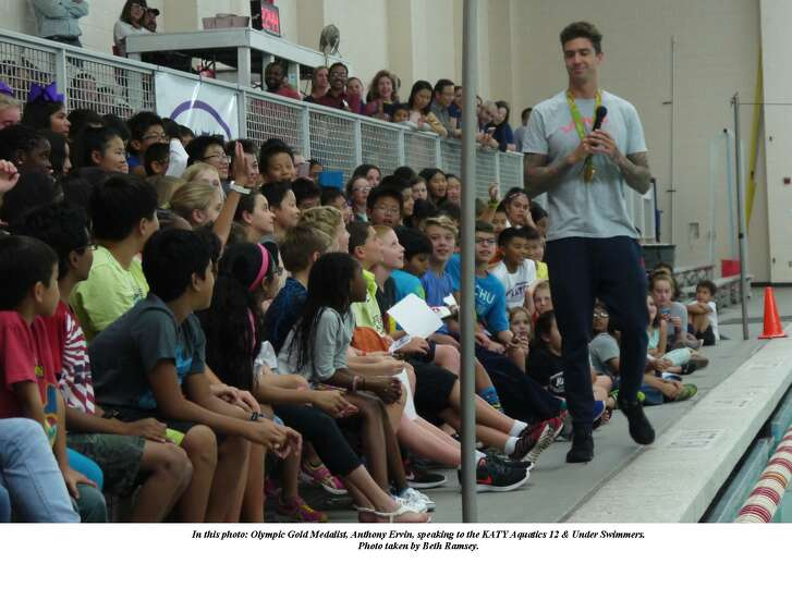 Olympic Gold Medalist Anthony Ervin speaks to the Katy Aquatics 12 and under swimmers.