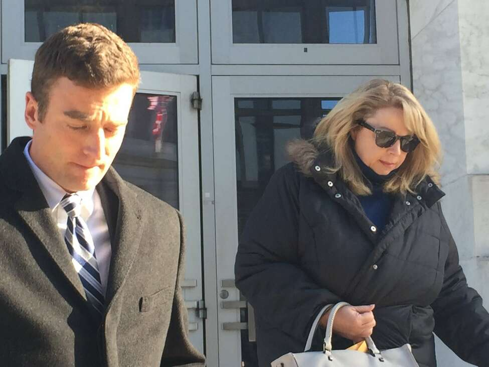 Diane L. Backis, who pleaded guilty to fraud, admitting she stole $3.1 million from her employer Cargill, leaves U.S.District Court Monday with her attorney, Scott Iseman. (Robert Gavin / Times Union)
