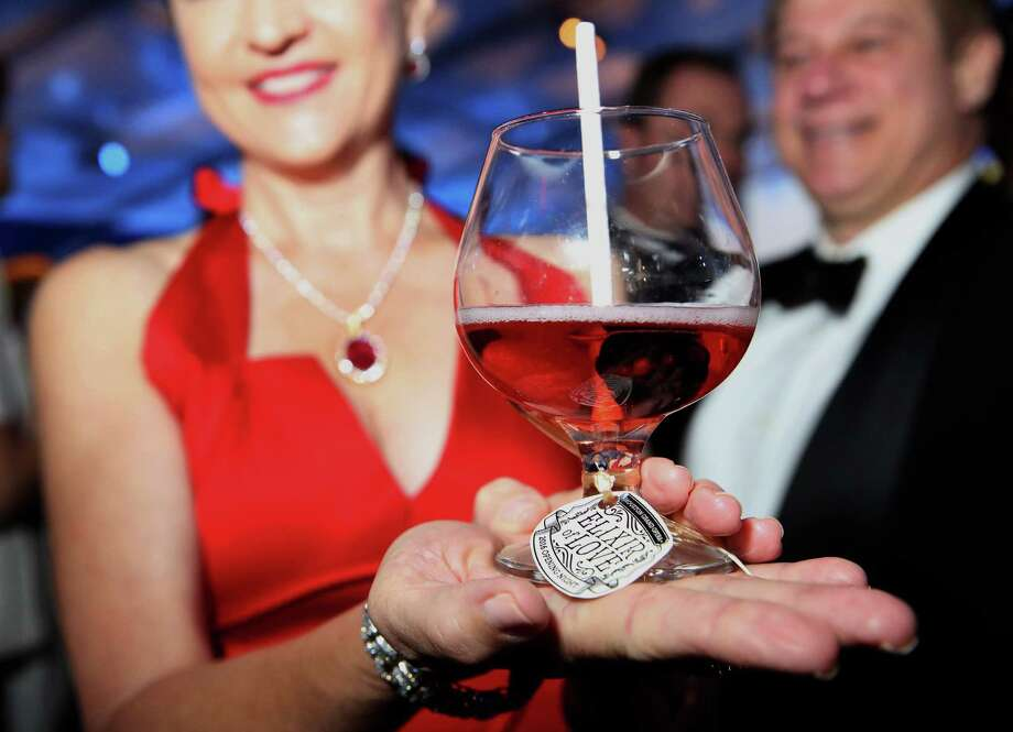 "Mary D'Andrea holds a glass of Houston Grand Opera Opening Night dinner special drink ""Elixir of Love"" for a photo Friday, Oct. 21, 2016, in Houston. (Yi-Chin Lee / Houston Chronicle ) Photo: Yi-Chin Lee, Staff / © 2016  Houston Chronicle"