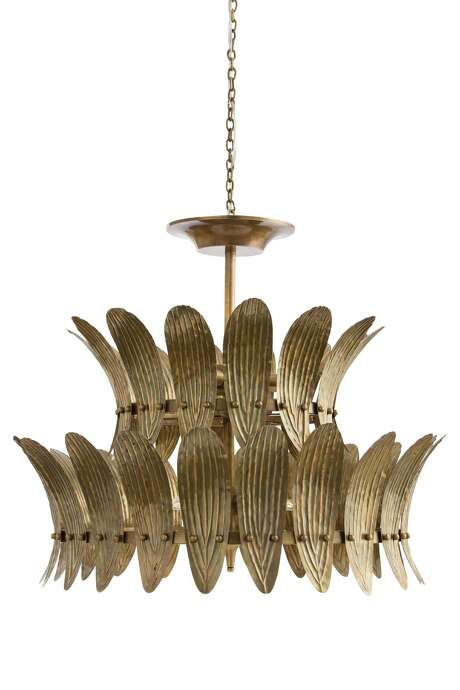 Analise Chandelier from Arteriors. The eight-light shandelier features gently-curbed plates embossed with a leaf motif and finished in vintage brass; $3,300 available at Area, 3735 Westheimer.