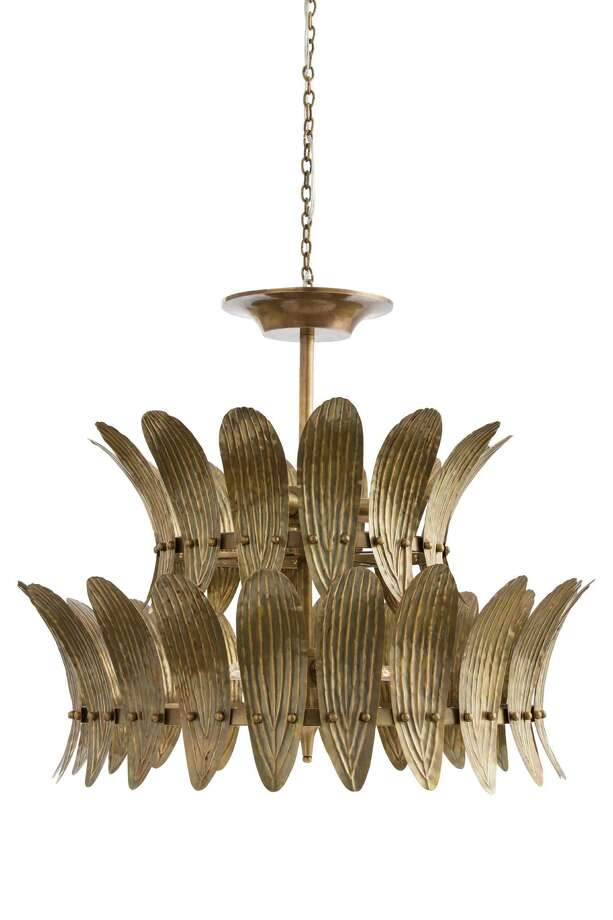 Analise Chandelier from Arteriors. The eight-light shandelier features gently-curbed plates embossed with a leaf motif and finished in vintage brass; $3,300 available at Area, 3735 Westheimer. Photo: Arteriors / Agent485 All Rights Reserved