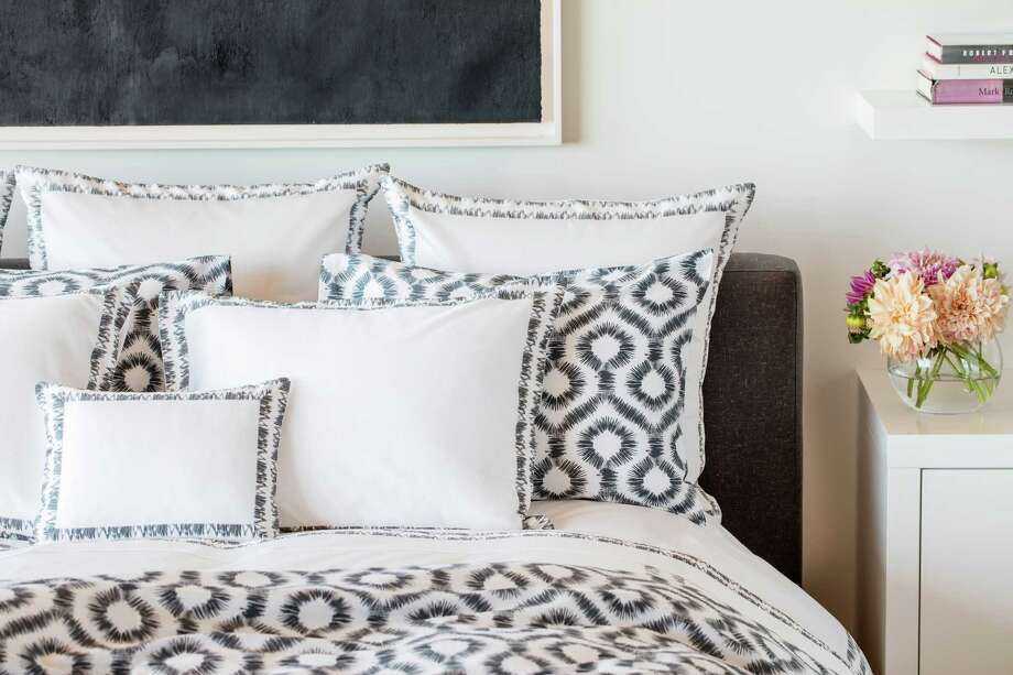 Houston-based luxury bedding line Tribute Goods' new fall collection, Abstract Ikat, is a modern take on a centuries-old, traditional pattern. The line is available in onyx and indigo. Photo: Michael Wells / Michael Wells