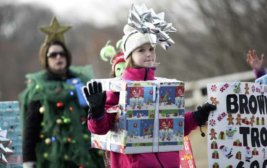Eight-year-old Akaya Karlsen, of Waterbury, marches with Brownie Troop 60067, of Seymour, in the 45th annual Seymour Christmas Parade in downtown Seymour on Sunday. Photo: Autumn Driscoll / Hearst Connecticut Media / Connecticut Post freelance