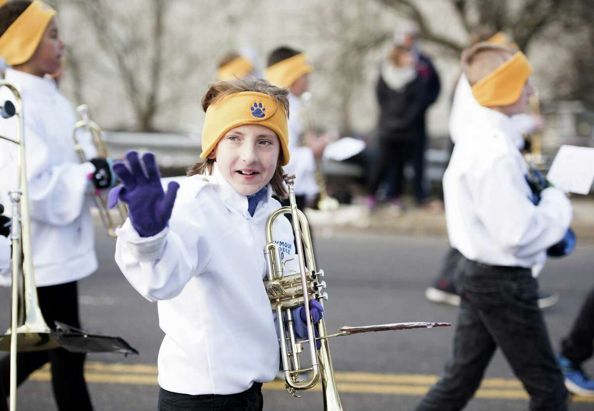 Lauren Burton, 11, marches with the Seymour Middle School Band in the 45th annual Seymour Christmas Parade in downtown Seymour, Connecticut Sunday, Nov. 27, 2016.