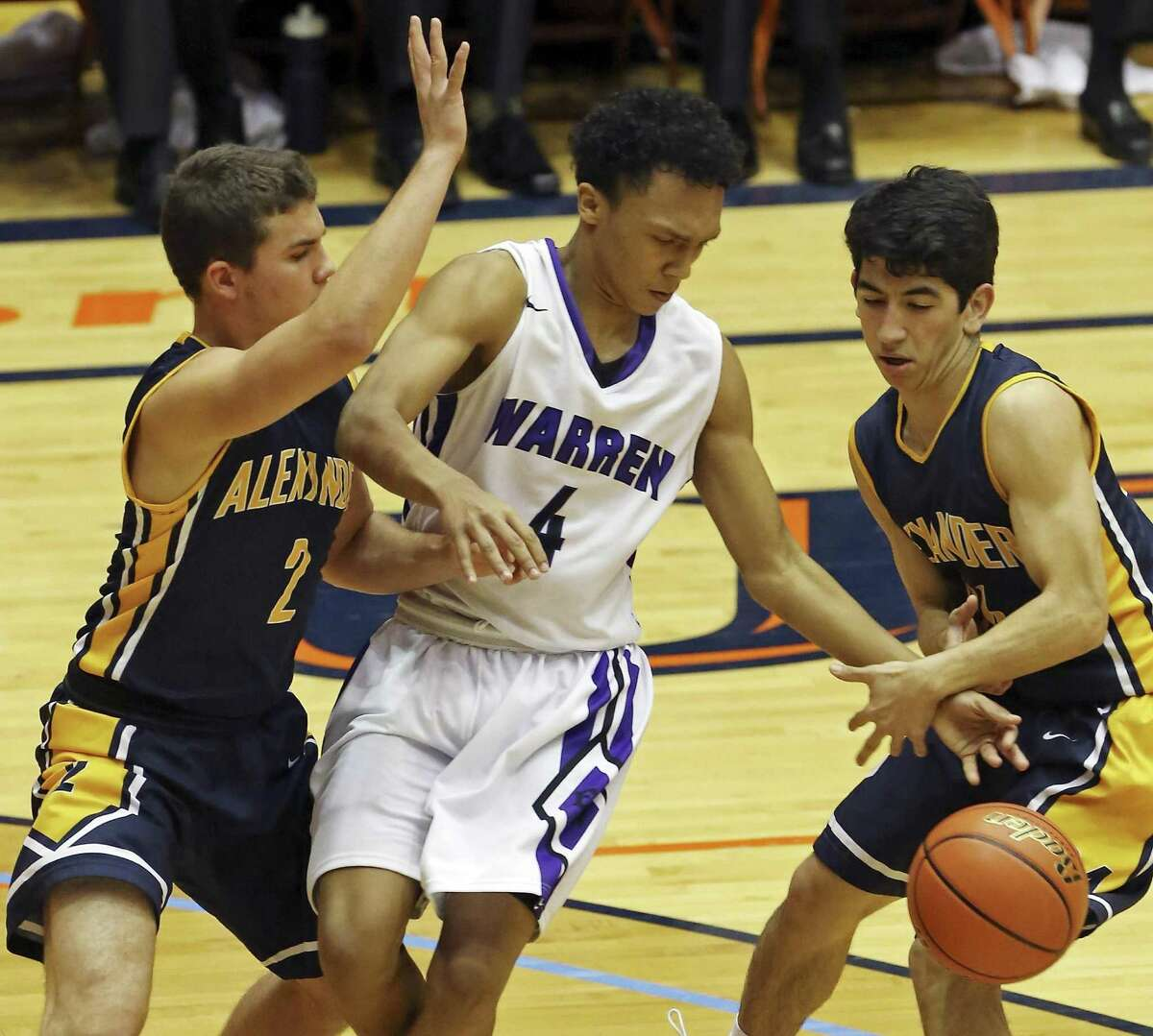 Warren's Isaiah Thorne looks for room between Laredo Alexander's Victor Martinez (left) and Elihu Diaz during first half action of a Region IV-6A semifinal playoff game on March 6, 2015 at the UTSA Convocation Center.