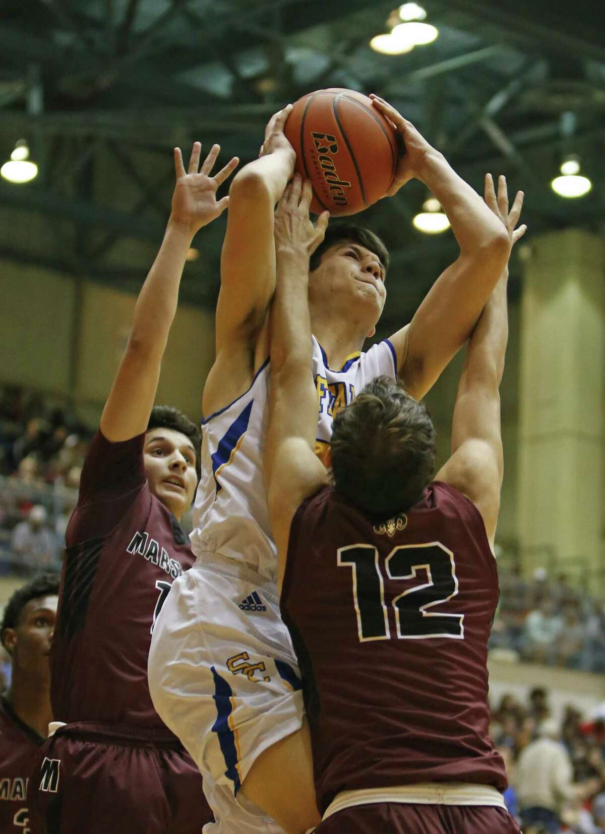 Clemens' Spencer Bone (with ball) is fouled by Marshall's Johnny Carrillo in a Region IV-6A third-round playoff game at UTSA.