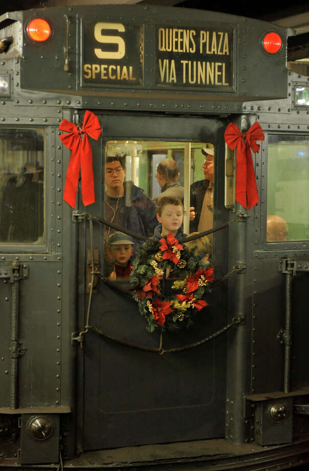 MTA New York City Transit has brought back the Holiday Nostalgia Train for 2016. Riders can experience subway cars in service from 1932 until 1977, complete with ceiling fans, padded seats and incandescent light bulbs from when the cars first ran. The train runs on the M line between 2 Av and Queens Plaza every Sunday from Thanksgiving through New Year's. Photo: Photo: MTA New York City Transit / Marc Hermann