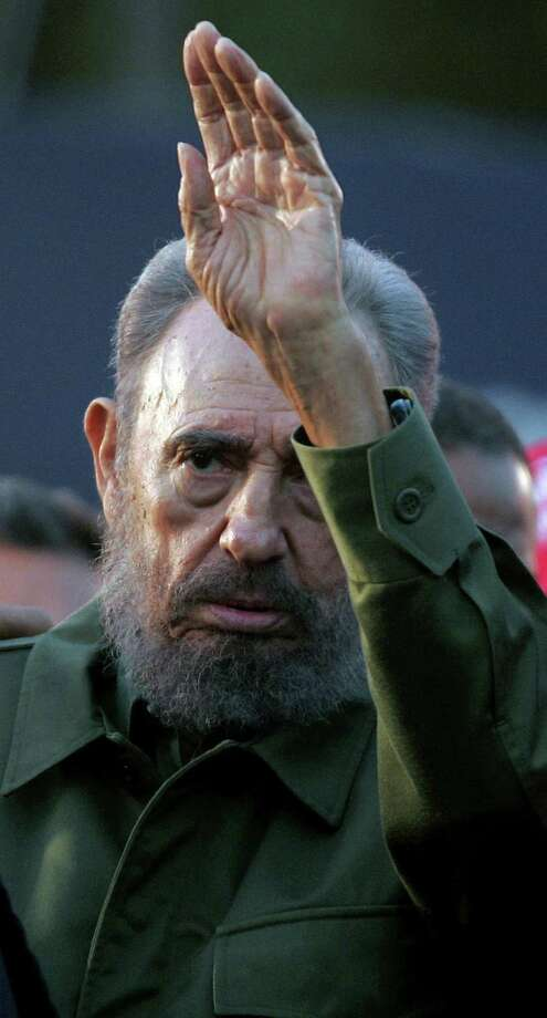 Cuban President Fidel Castro waving at a crowd in 2006 during a political rally during the Alternative Summit, following the Mercosur Summit. Castro died late Friday in Havana. Photo: JUAN MABROMATA /AFP /Getty Images / AFP or licensors