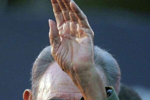 Cuban President Fidel Castro waving at a crowd in 2006 during a political rally during the Alternative Summit, following the Mercosur Summit. Castro died late Friday in Havana.