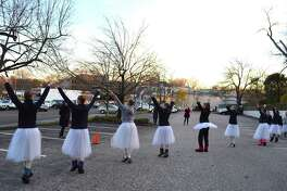 Members of the New England Academy of Dance rehearse for the annual tree lighting ceremony sponsored by the Darien Sport Shop, Sunday, Nov. 27, 2016, in Darien, Conn.