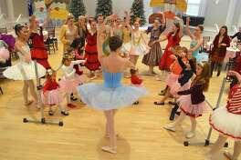 The Sugar Plum fairy does a ballet demonstration at the Westport Woman's Club's 3rd annual Nutcracker Tea Party, Saturday, Nov. 26, 2016, in Westport, Conn.