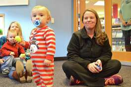 Adrian Bova, 13 Months, and mom Emily, of New Canaan, played the rhythm eggs along with Robert the Guitar Guy when he made an appearance at the New Canaan Library on Sunday, Nov. 27, 2016, in New Canaan, Conn.