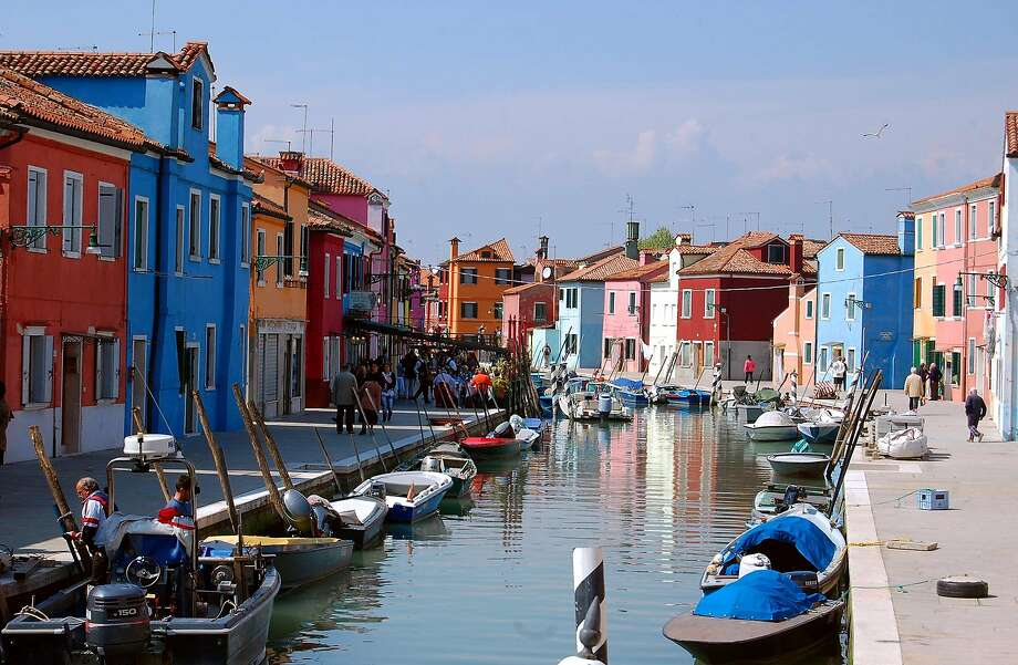 Colorful buildings line the canals of the small island of Burano in Venice's lagoon. Photo: Rick Steves