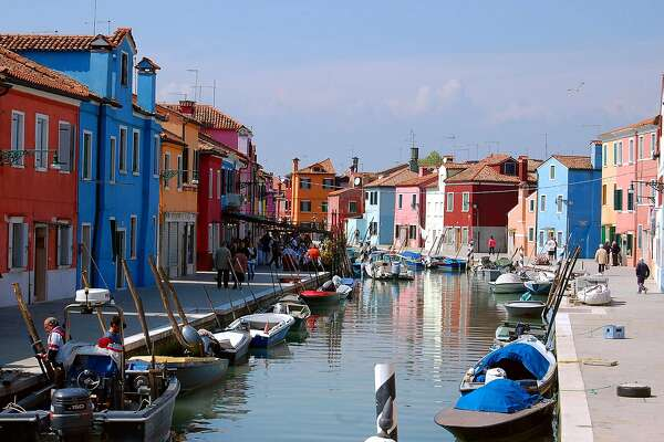 Colorful buildings line the canals of the small island of Burano in Venice�s lagoon.
