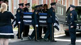 as the casket bearing the body of SAPD Det. Benjamin Marconi leaves Porter Loring Mortuary, 1101 McCullough Ave., for funeral services at the Community Bible Church on Loop 1604 on Monday, Nov. 28, 2016.  Marconi was shot dead in his patrol car outside police headquarters on Nov. 20.  MARVIN PFEIFFER/ mpfeiffer@express-news.net