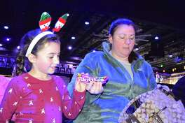 """Abigail King, 6, and her mom, Jennifer, of Trumbull, prepare for the sold out """"Frozen"""" Sing-Along at the Fairfield Theatre Company, Saturday, Nov. 26, 2016, in Fairfield, Conn."""
