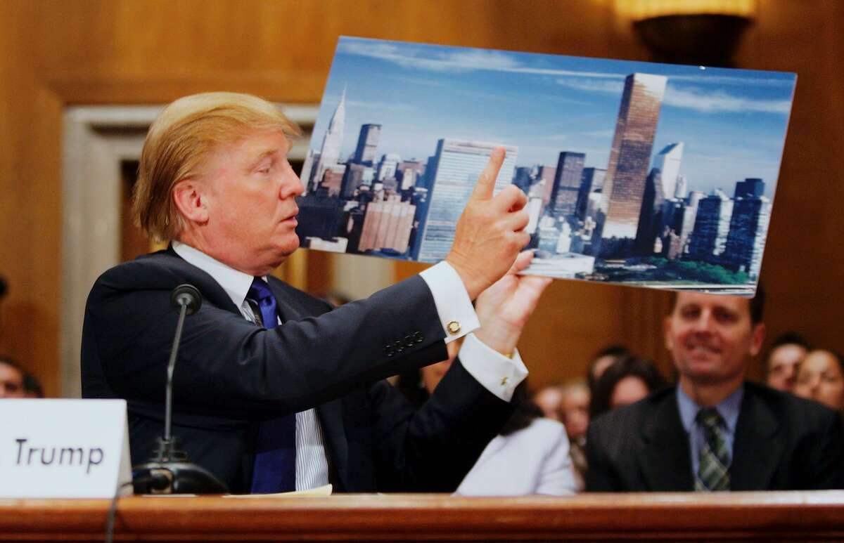Donald Trump displays a picture of the New York City skyline showing his Trump World Tower (R) near the United Nations as he testifies before the Federal Financial Management, Government Information, and International Security Subcommittee Capitol Hill July 21, 2005 in Washington, DC.