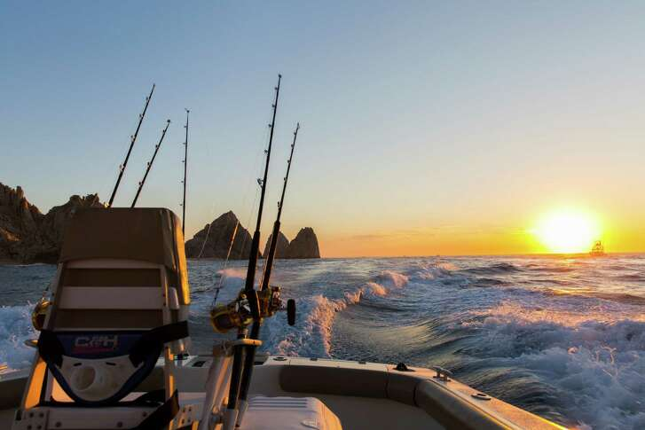 top: The fighting chair aboard pisces sportfishing's tiburon faces the early-morning sun.  right: Fishing boats pass cabo's famous arch on their way out to sea.  Far right: flora farms has a popular field-to-table restaurant.