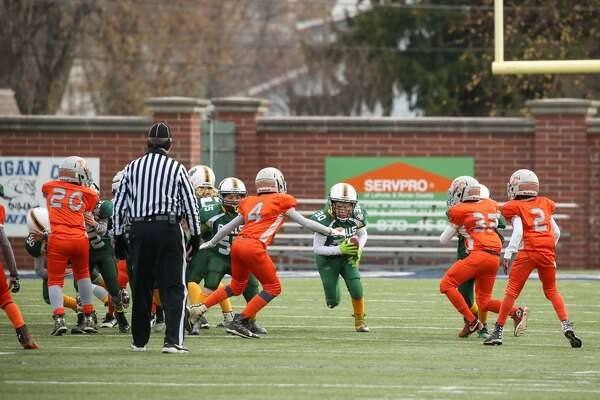 The New Milford Bulls, in green, lost 19-0 to the East Cleveland Chiefs, in orange, Saturday. The game was played in Indiana.