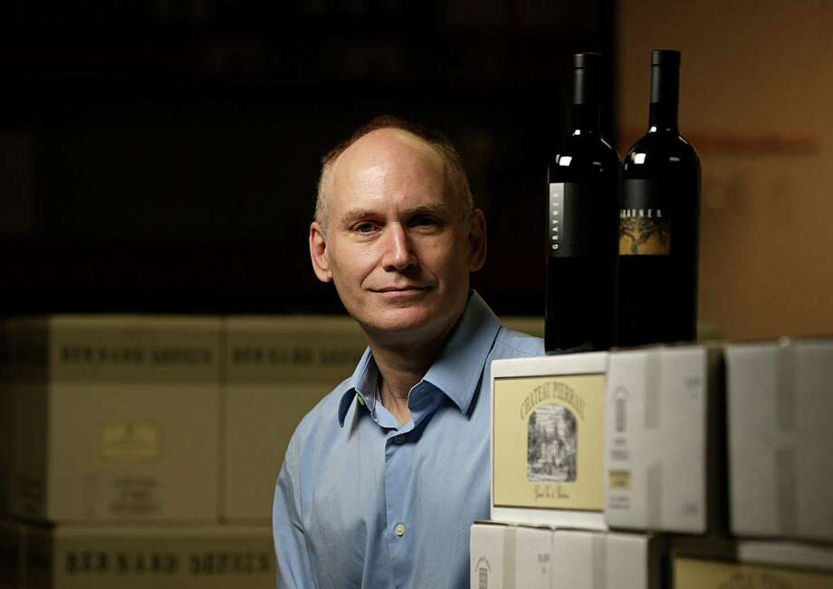 Dionysus Imports' Douglas Skopp poses for a portrait with bottles of Gravner wine from Nov. 4, 2016, in Houston. ( James Nielsen / Houston Chronicle ) Photo: James Nielsen, Staff / © 2016  Houston Chronicle