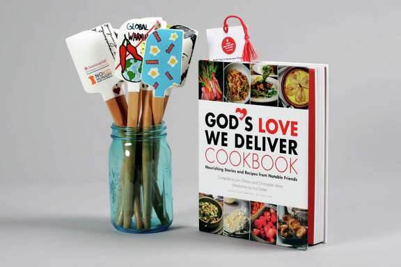 "This photo shows the No Kid Hungry Chef Series Silicone Spatulas and the ""God's Love We Deliver's Cookbook: Nourishing Stories and Recipes from Notable Friends,"" Thursday, Sept. 29, 2016, in New York. Proceeds from the sale of the book and spatulas go to charity. (AP Photo/Richard Drew)"