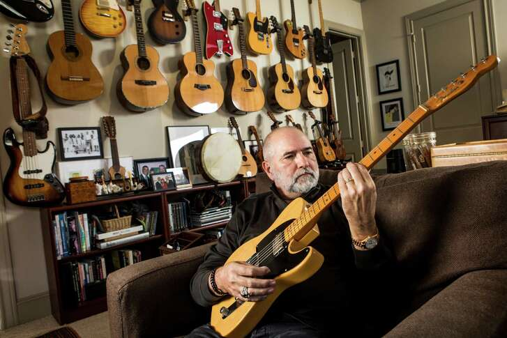 Bob Cavnar poses for a portrait with some of his guitar collection on Thursday, Oct. 13, 2016, in Houston. ( Brett Coomer / Houston Chronicle )