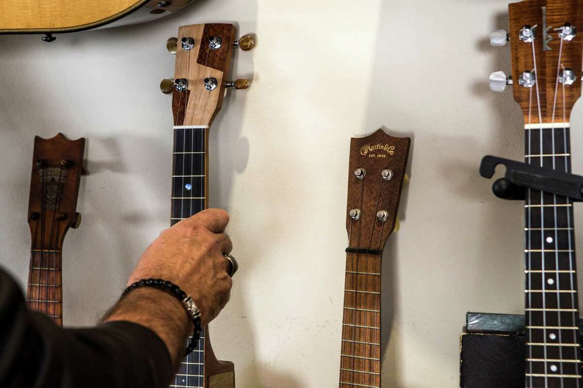 Bob Cavnar reaches out to pick up one of his instrument collection at his home on Thursday, Oct. 13, 2016, in Houston. ( Brett Coomer / Houston Chronicle )