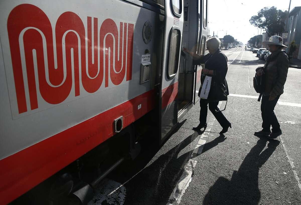 Passengers board an inbound N-Judah streetcar at 48th Avenue in San Francisco, Calif. on Thursday, Aug. 27, 2015.