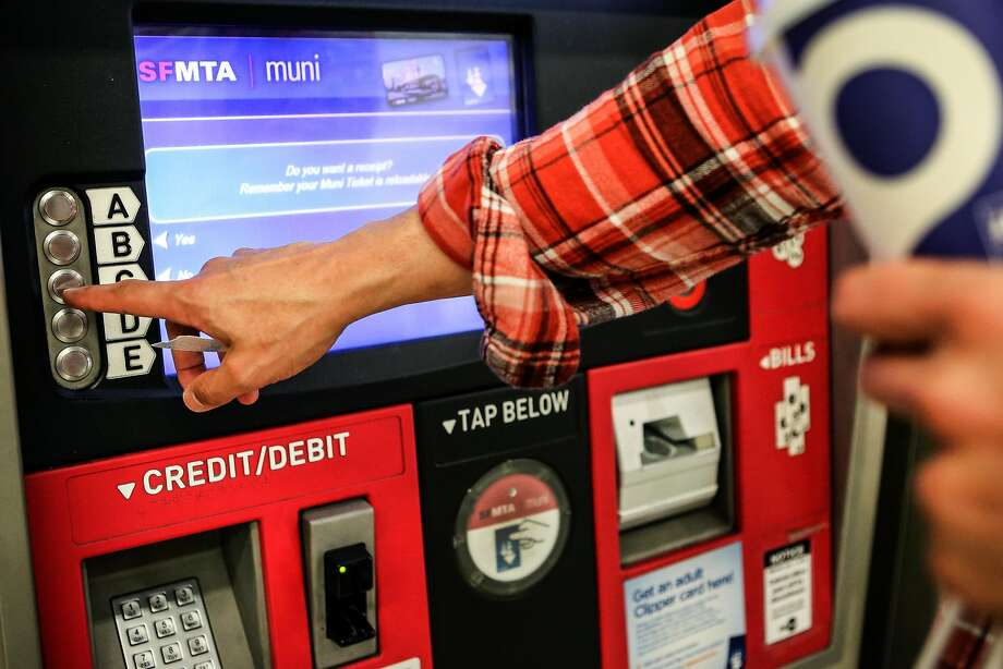 A passenger purchases a Muni ticket from a kiosk at Powell Station on Monday, November 29, 2016. Photo: Amy Osborne, Special To The Chronicle