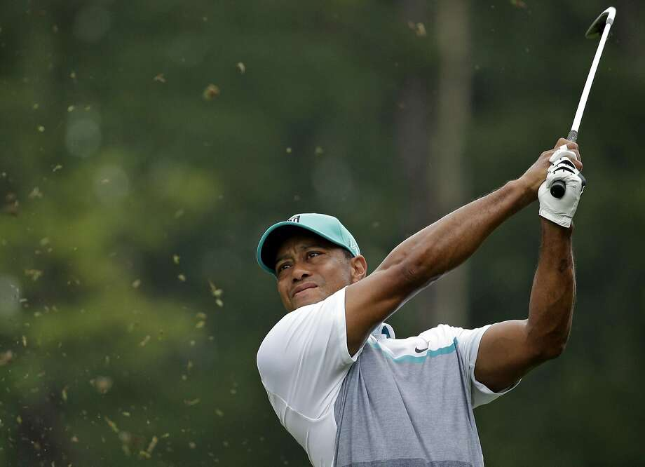 After 15 months away following back surgery, Tiger Woods returned at the 2015 Wyndham Championship, tying for 10th. Photo: Chuck Burton, Associated Press